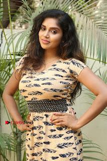Telugu Actress Karunya Chowdary Stills in Short Dress at ATM Not Working Press Meet  0044.jpg