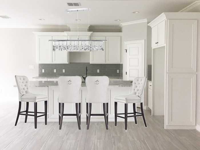 White kitchen with shaker cabinets with counter height barstools | via monicawantsit.com