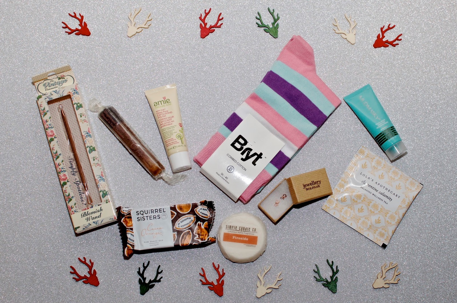 striped socks, reindeer confetti, chocolate, jewelry, and beauty products