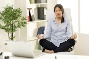 8 Yoga Poses You Can Do in Your Desk Chair