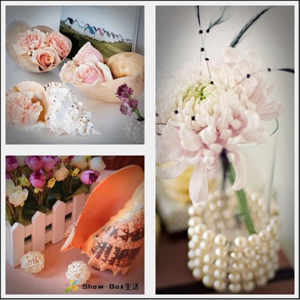 Decoração com flores, conchas e pérolas