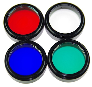 photograph of red, clear, blue, and green filters