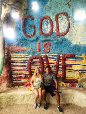 Couple inside adobe huts of Salvation Mountain