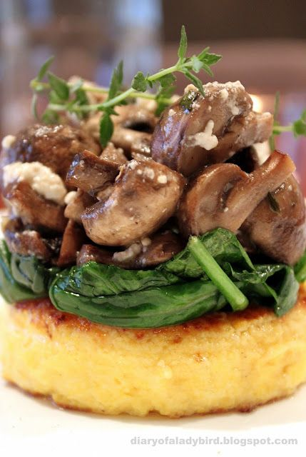 Polenta rounds with wilied spinach and roast mushrooms