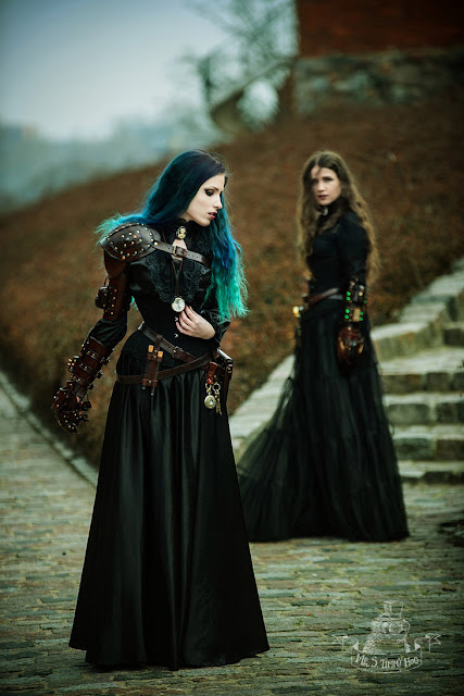 Steamgoths wearing gothic steampunk clothing and large leather gauntlets. women's steampunk clothing and accessories