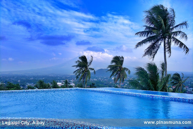 The Oriental Legazpi hotel's infinity pool with a view of Mayon and Lignon Hill