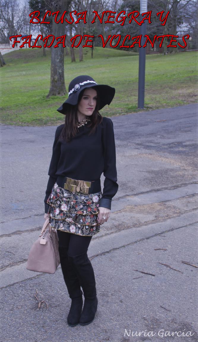 Blusa negra y falda de volantes con flores