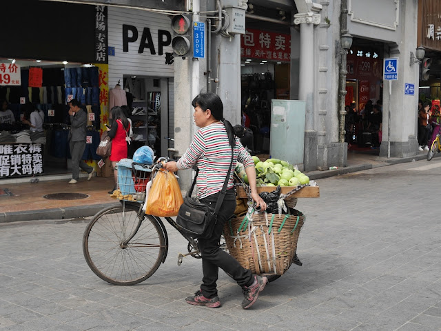 woman selling fruit from a bike