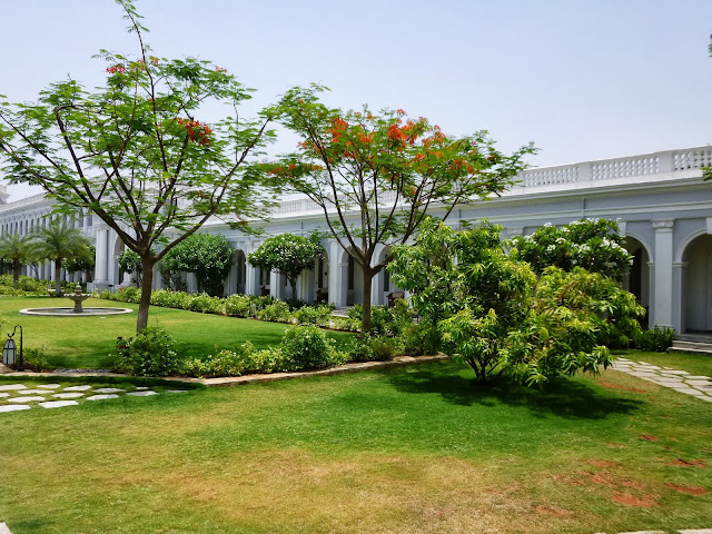 Falaknuma Palace Hyderabad Images: Flowering trees in the courtyard