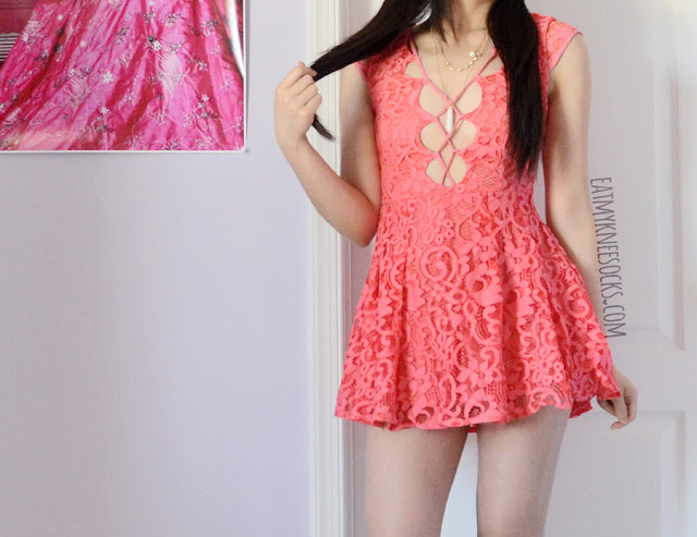 Details on the coral pink Wendy lace-up plunging fit-and-flare skater dress from Australian designer boutique Selfie Leslie; this spring-ready lace dress combines sexy and cute for an ultra-flattering fit and eye-catching style!
