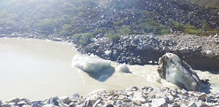 Photo of ice boulders being washed away from Thothormi Lake. Image taken in June 2019 by National Center for Hydrology and Metereology.
