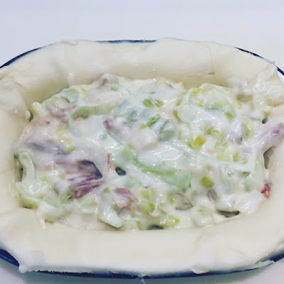 Ham and Leek Pie filling in the pastry case