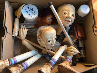 photo of sculpted and painted puppet body parts made by Corina Duyn, gathered in a box