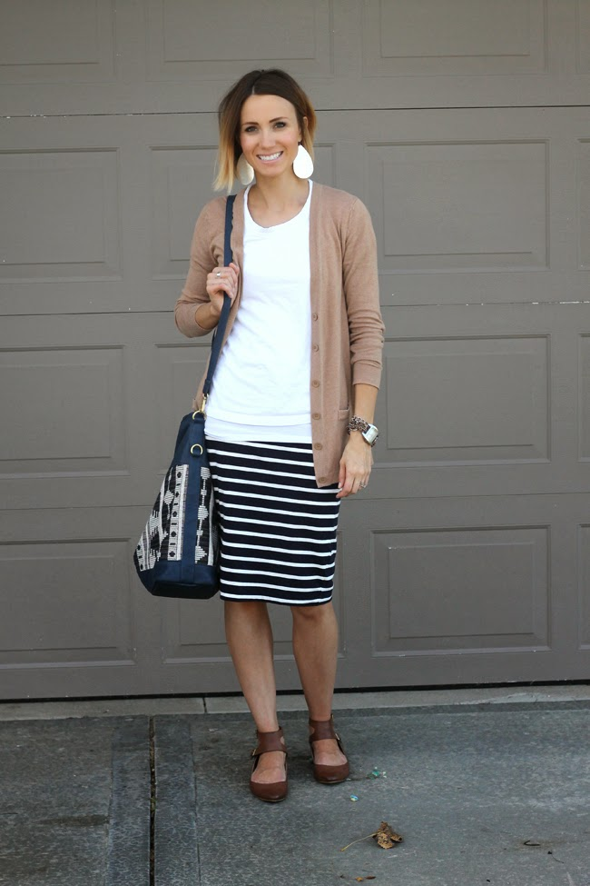 Camel boyfriend cardigan, navy striped skirt, ankle strap flats