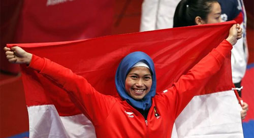 GOLD MEDAL : Defia Rosmaniar gave the first Gold medal for Indonesian contingent on ASIAN GAMES 2018. She defeated Iranian Athletes right away, Photo courtesy DETIK.COM