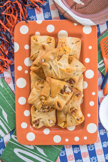 Crack Chicken Crescent Bites - chicken, bacon, cheddar and ranch baked in crescent rolls. SO addictive!!! I took these to a party and they flew off the plate. You might want to double this recipe. Everyone RAVES about this easy chicken recipe. Great for tailgating, parties, lunch and dinner. Can make chicken mixture ahead of time and assemble crescents when ready to bake. SO GOOD!!!
