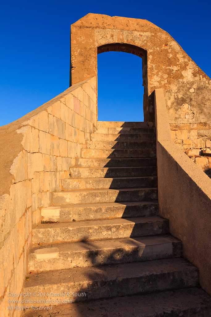 a photograph of a stairway atop the city walls in dubrovnik croatia