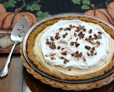 No-Bake Pumpkin Cream Pie ♥ AVeggieVenture.com, a simple creamy pumpkin pie, part pie, part cheesecake in an easy no-rolling press-in gingersnap crust. Totally simple and pleasing! Recipe, baking tips, nutrition, WW Weight Watchers points included.