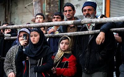 Children watching a public hanging in Iran