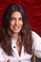 Priyanka Chopra in White Shirt and Colorful Skirt at Baywatch Press Conference  15th May 2017 ~  Exclusive 17.jpg