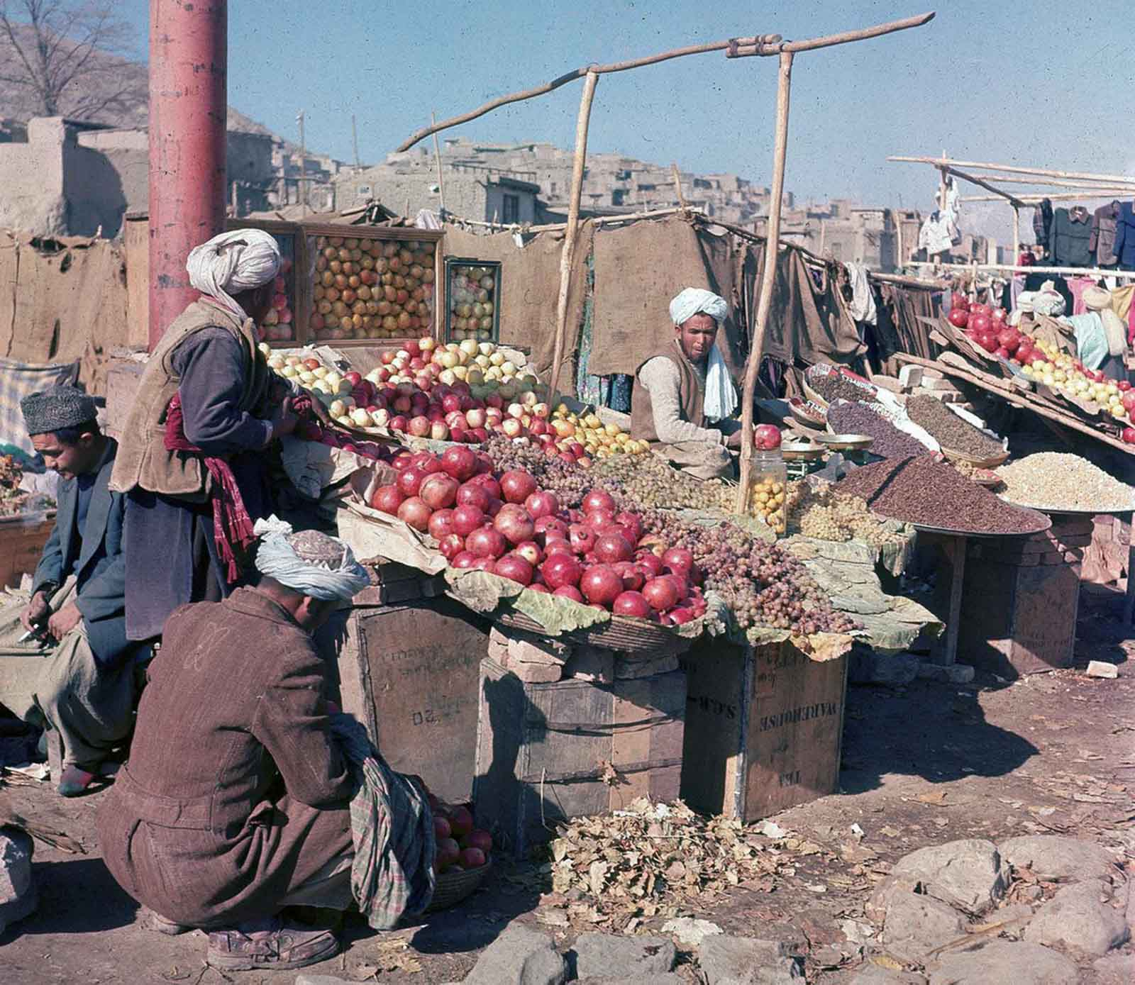 Vendors sell various fuits and nuts at an outdoor market in Kabul, in November of 1961.