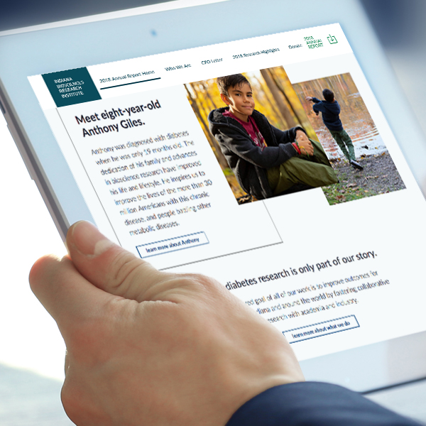 A businessman uses his iPad to browse IBRI's 2018 annual report