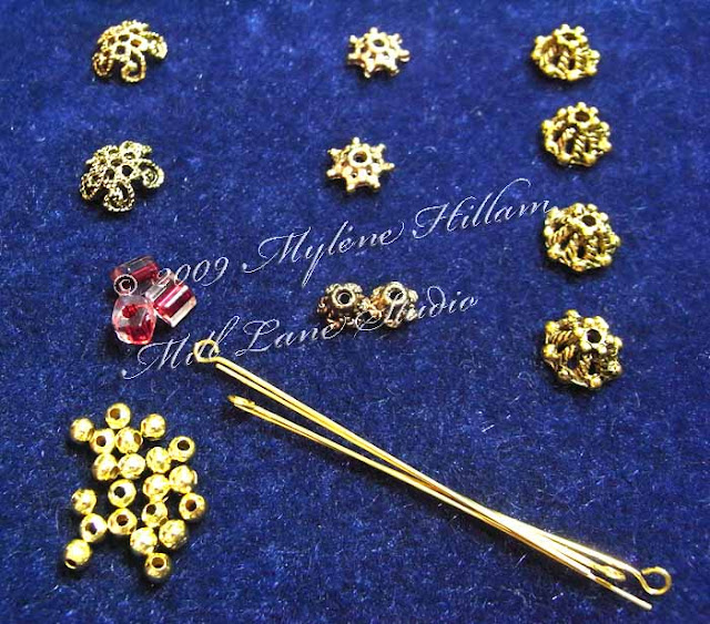 Selection of gold textured bead caps and jewellery findings