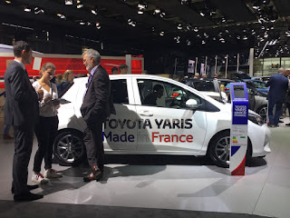 Pic of customer and Toyota staff noting details in front of Toyota Yaris Made in France
