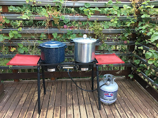 Photo of two-burner propane campstove set up for boiling water bath and pressure canning. https://trimazing.com/