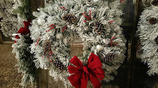 flocked pine wreath with pine cones and red bow from T&S Christmas Tree Farm in Hawarden, Iowa