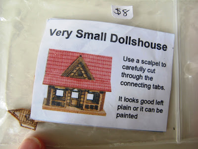 'Very small dollshouse' kitset with thumb for scale.
