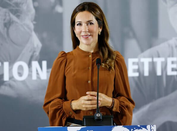 Crown Princess Mary wore a rockstud patent leather pumps by Valentino. balloon puff long sleeve silk blouse, black trousers, multicolor belt
