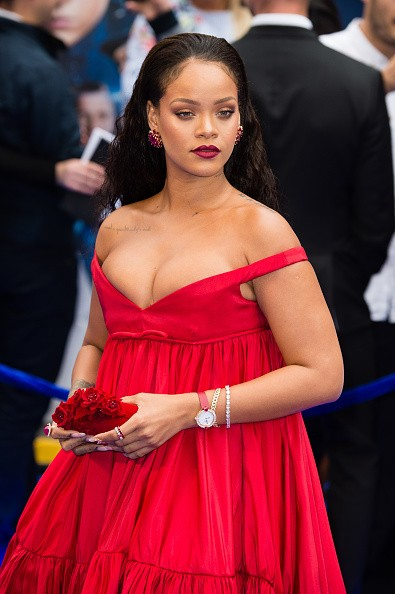 Rihanna Flaunts Her Ample Assets in low-cut scarlet Gown
