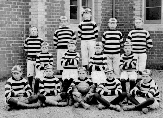 Photograph of North Mymms School Football Team. Back Row: Tom ores, Frank Aslott, W. Archer, F. Hill, Tom Pollard. Middle Row: T. Pollard, G. Mallet, Ted Canham, Twiddles Nash. Front Row: Tom Nott, Charley Read, Stanley Nash, Bob Canham, Tom Nash. 1902-03. Image from A. Nott / G. Knott