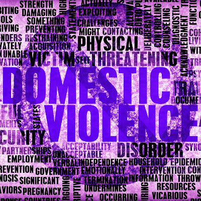 poster featuring a montage of words about domestic violence with a no sign over it.