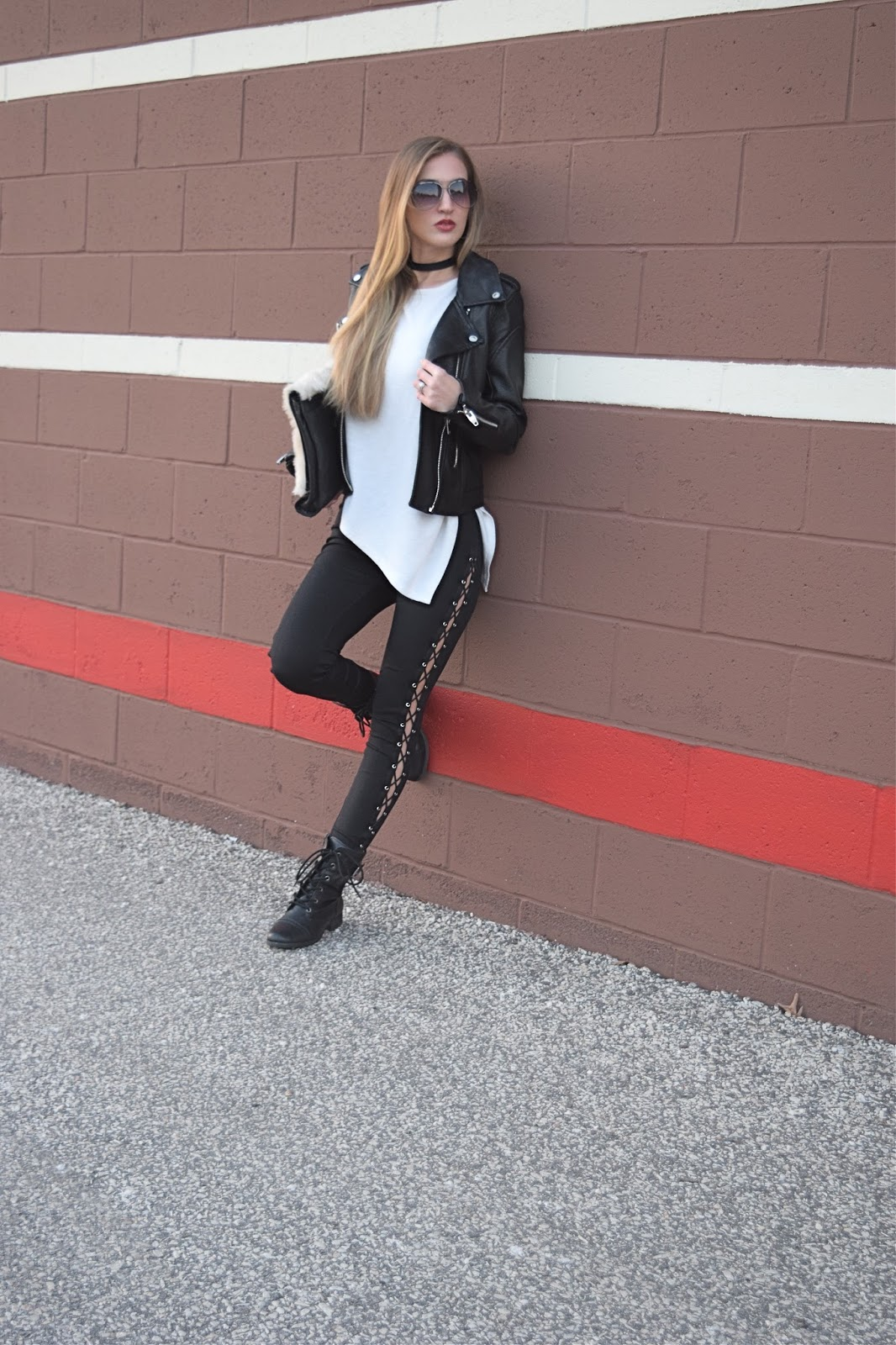 Wearing Blank NYC easy rider faux leather jacket, Express lace up leggings, little liffner fur clutch, leather jacket look with leggings