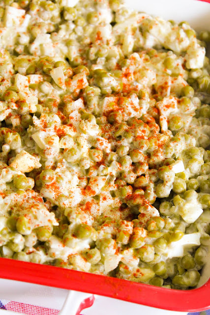 Old School, Pea Salad, a classic salad made with simple ingredients, crunchy pieces of onion, chopped dill pickles, and boiled eggs with a coating of mayonnaise.  An easy summer salad perfect for potlucks and gatherings.