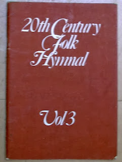 picture of the cover of teh twentieth century folk-hymnal volume 3:  brown cover with white script writing