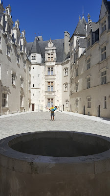 All is well in the courtyard in the Pau Castle. Get it? That's a well in the front of the pic