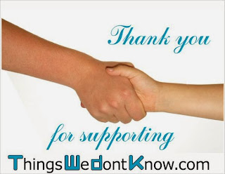 Thank you from TWDK. Photograph of two people shaking hands.