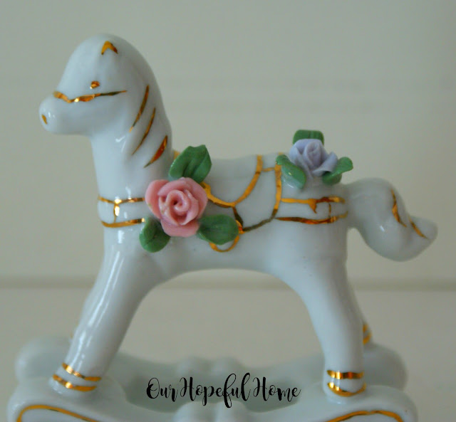 Vintage Enesco porcelain rocking horse with gilding and flowers