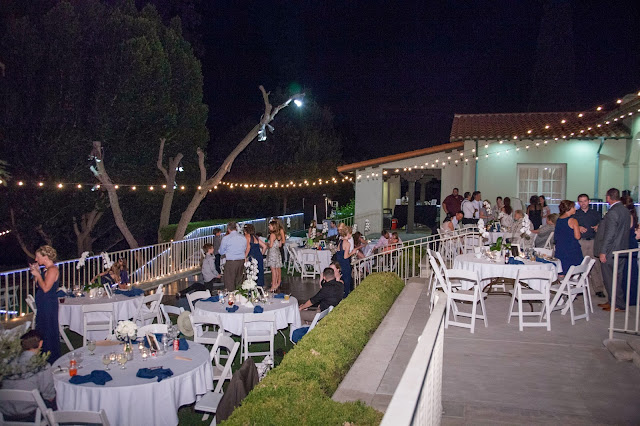 Our Kellogg House Wedding and Reception was absolutely beautiful. The backyard was perfect with white linens and bistro lights over the yard.