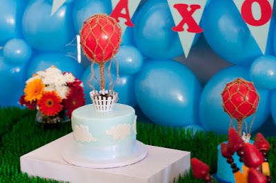 up up and away themed birthday cake with balloon