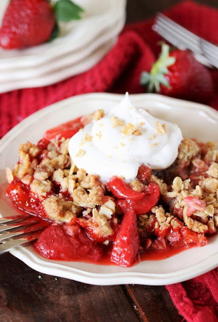 Fresh Strawberry Crisp Topped with Whipped Cream Image