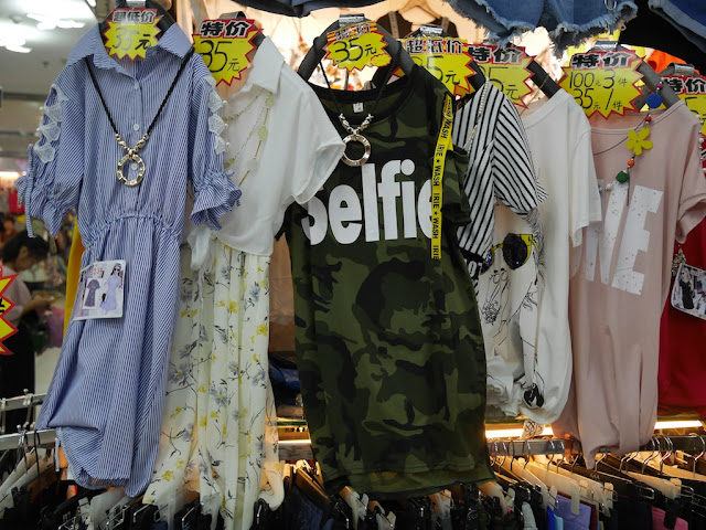 "dress with camouflage pattern and the word ""Selfie"""