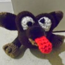 http://www.craftsy.com/pattern/crocheting/toy/doggie-door-prop-a-crochet-pattern/82576