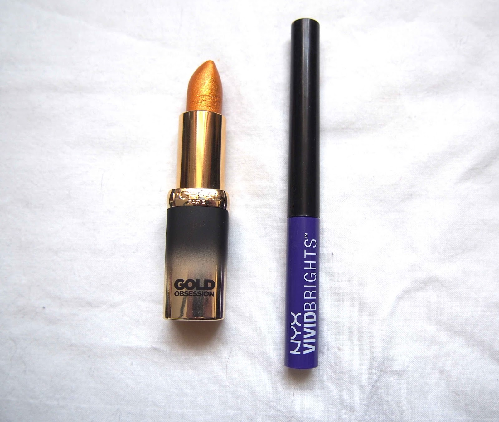 gold lipstick, loreal gold obsession riche lipstick pure gold, gold lipstick, lilac purple eyeliner, colourful makeup, subtle festival makeup, grunge makeup and hair, nyx vivid brights vivid violet 1