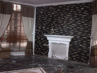 dark ledge stone done on a tv wall