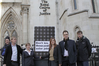 Campaigners against feed-in tariff cuts outside the High Court yesterday
