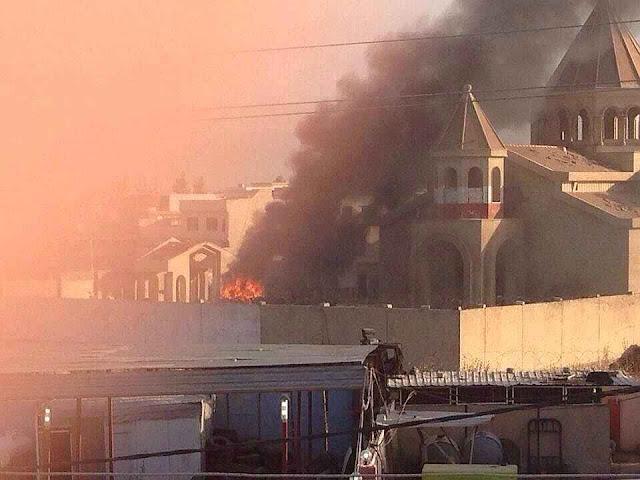 Incêndio da catedral de Mosul, nessa hora o frei Michael estava desaparecido resgatando documentos históricos.